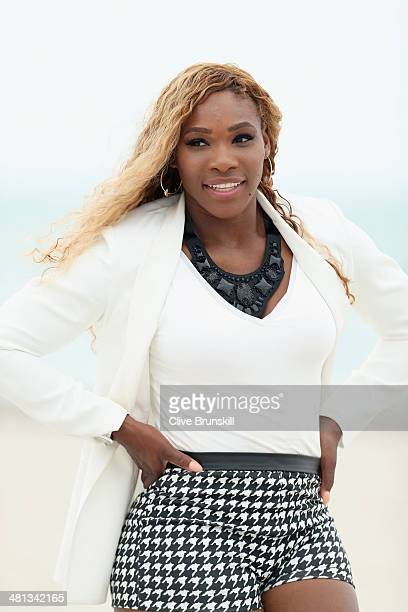 Serena Williams of the United States poses for photographs on Crandon Park beach after her straight sets victory against Li Na of China during their...
