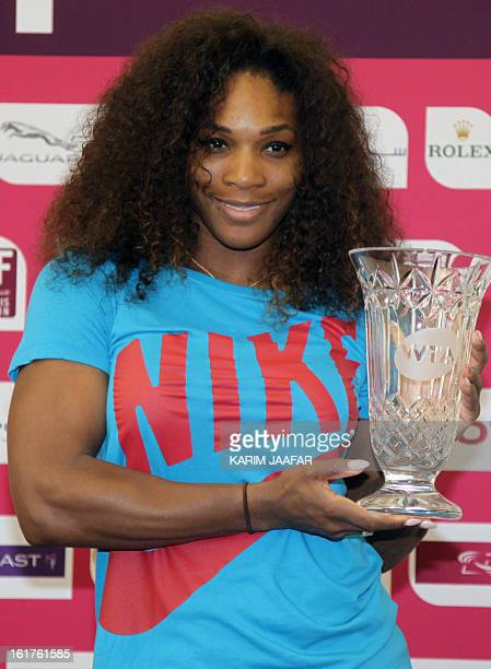 Serena Williams of the United States poses with a trophy given to her by the WTA Tour after the 31yearold American reclaimed the world number one...