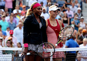 Serena Williams of the United States poses with Caroline Wozniacki of Denmark prior to their women's singles final match on Day fourteen of the 2014...