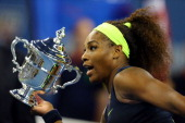 Serena Williams of the United States poses with the championship trophy after defeating Victoria Azarenka of Belarus to win the women's singles final...