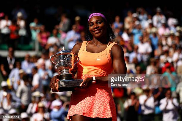 Serena Williams of the United States poses with the Coupe Suzanne Lenglen trophy after winning the Women's Singles Final against Lucie Safarova of...