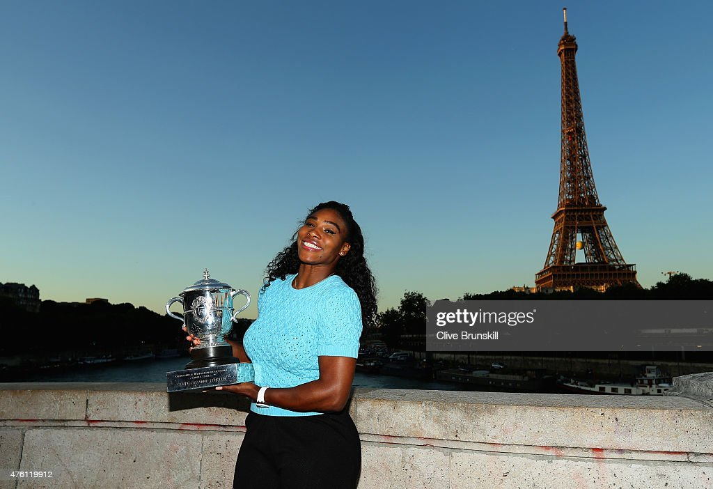 Serena Williams of the United States poses with the Coupe Suzanne Lenglen trophy on day fourteen of the 2015 French Open at Pont Bir Hakeim on June 6, 2015 in Paris, France.