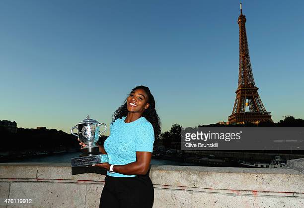 Serena Williams of the United States poses with the Coupe Suzanne Lenglen trophy on day fourteen of the 2015 French Open at Pont Bir Hakeim on June 6...
