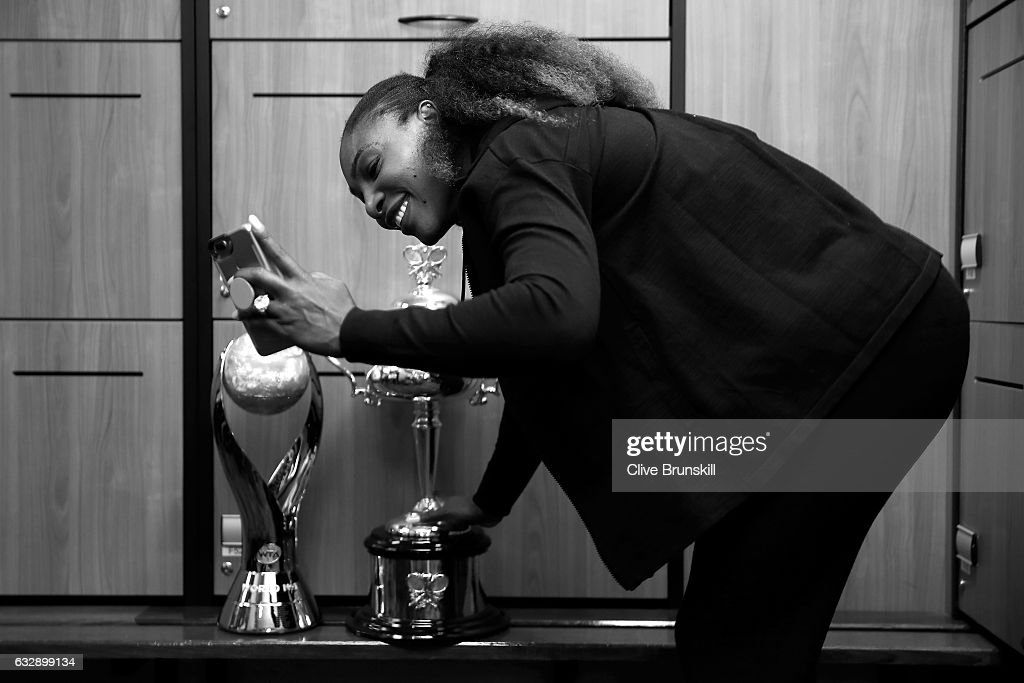 Serena Williams of the United States poses with the Daphne Akhurst Trophy in the change-rooms after winning the Women's Singles Final against Venus Williams of the United States on day 13 of the 2017 Australian Open at Melbourne Park on January 28, 2017 in Melbourne, Australia.