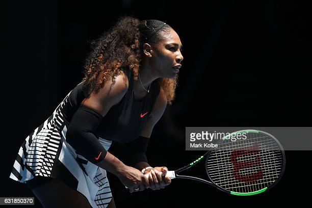 Serena Williams of the United States prepares to return serve in her first round match against Belinda Bencic of Switzerland on day two of the 2017...