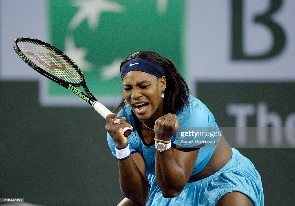 Serena Williams of the United States reacts after breaking Agnieszka Radwanska of Poland serves during the second set tie-breaker during day twelve of the BNP Paribas Open at Indian Wells Tennis Garden on March 18, 2016 in Indian Wells, California.