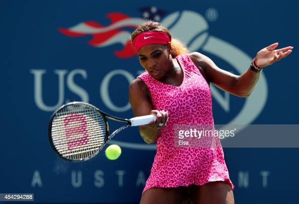 Serena Williams of the United States returns a shot against Vania King of the United States during their women's singles second round match on Day...