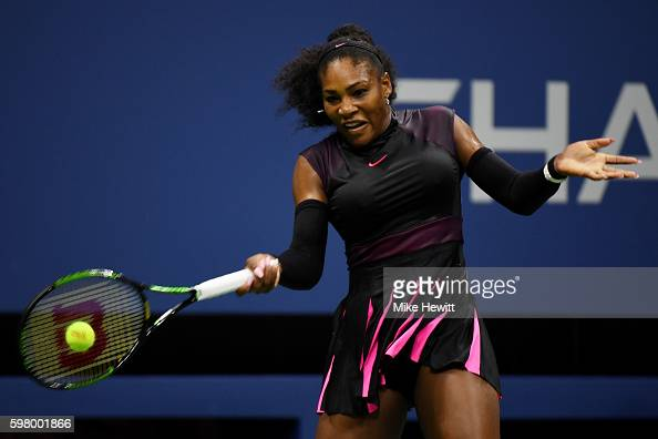 Serena Williams of the United States returns a shot to Ekaterina Makarova of Russia during her first round Women's Singles match on Day Two of the...
