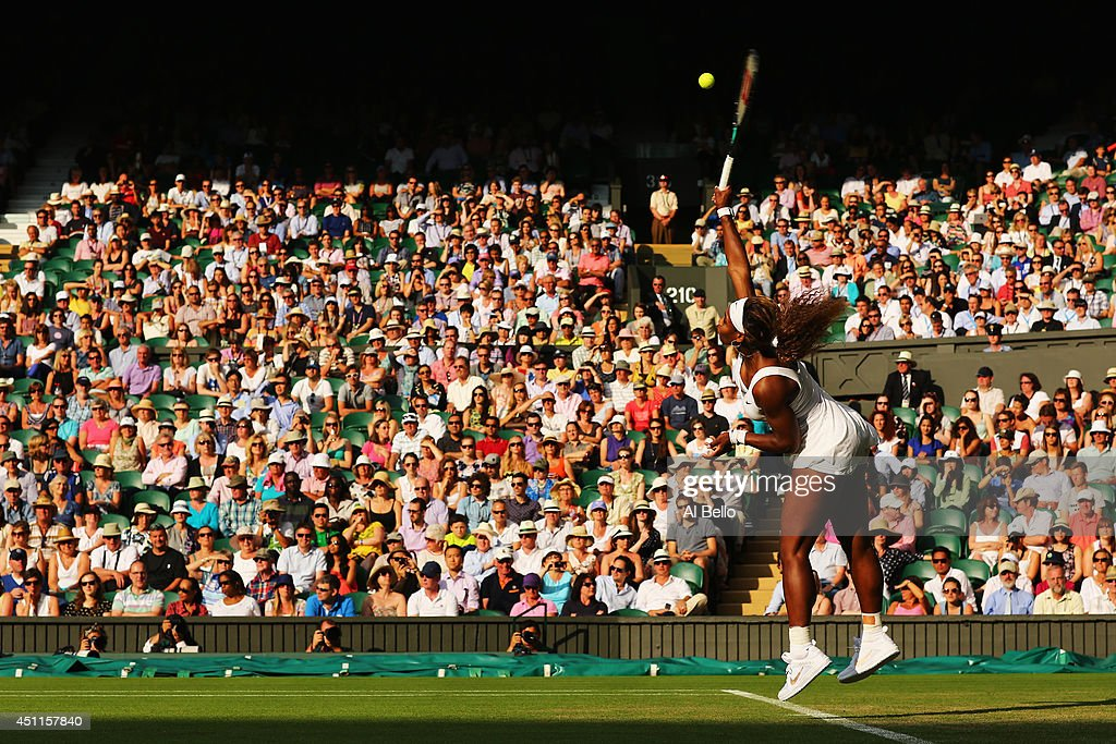 Serena Williams of the United States serves during her Ladies' Singles first round match against Anna Tatishvili of the United States on day two of the Wimbledon Lawn Tennis Championships at the All England Lawn Tennis and Croquet Club at Wimbledon on June 24, 2014 in London, England.