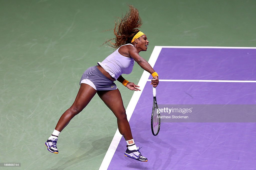 <a gi-track='captionPersonalityLinkClicked' href=/galleries/search?phrase=Serena+Williams&family=editorial&specificpeople=171101 ng-click='$event.stopPropagation()'>Serena Williams</a> of the United States serves to Agnieszka Radwanska of Poland during day two of the TEB BNP Paribas WTA Championships at the Sinan Erdem Dome on October 23, 2013 in Istanbul, Turkey.