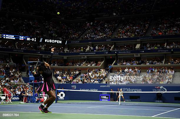 Serena Williams of the United States serves to Ekaterina Makarova of Russia during her first round Women's Singles match on Day Two of the 2016 US...