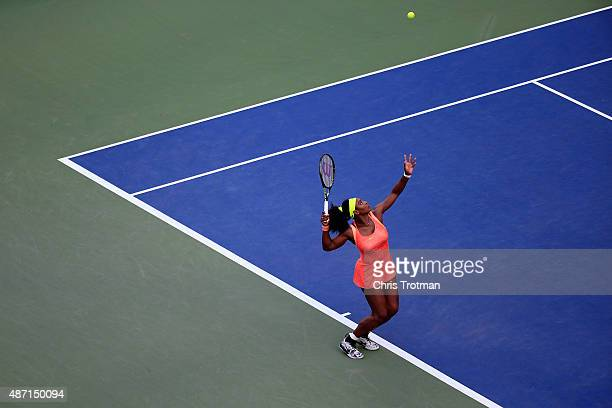 Serena Williams of the United States serves to Madison Keys of the United States during their Women's Singles Fourth Round match on Day Seven of the...