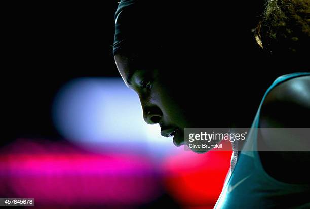 Serena Williams of the United States shows her frustrations during her straight sets defeat by Simona Halep of Romania in their round robin match...