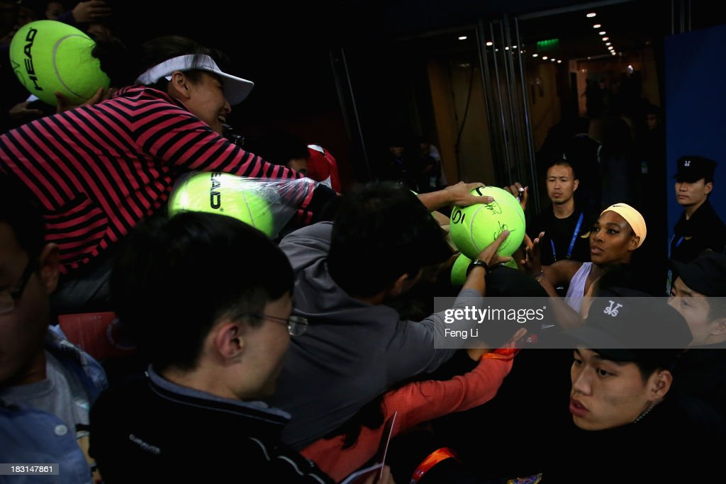 <a gi-track='captionPersonalityLinkClicked' href=/galleries/search?phrase=Serena+Williams&family=editorial&specificpeople=171101 ng-click='$event.stopPropagation()'>Serena Williams</a> of the United States (Right) signs for fans after winning against Agnieszka Radwanska of Poland during her women's semi-final match on day eight of the 2013 China Open at the National Tennis Center on October 5, 2013 in Beijing, China.