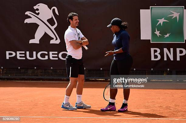 Serena Williams of the United States speaks to coach Patrick Mouratoglou during a training session on Day One of The Internazionali BNL d'Italia 2016...