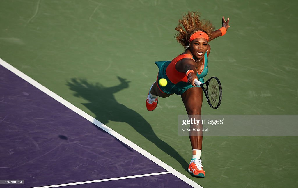 Serena Williams of the United States stretches for a backhand against Yaroslava Shvedova of Kazakhstan during their second round match during day 4 at the Sony Open at Crandon Park Tennis Center on March 20, 2014 in Key Biscayne, Florida.