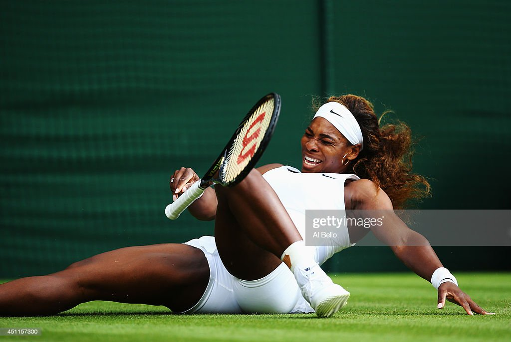 Serena Williams of the United States takes a tumble during her Ladies' Singles first round match against Anna Tatishvili of the United States on day two of the Wimbledon Lawn Tennis Championships at the All England Lawn Tennis and Croquet Club at Wimbledon on June 24, 2014 in London, England.