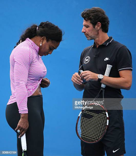 Serena Williams of the United States talks to coach Patrick Mouratoglou during a practice session on day eight of the 2016 Australian Open at...