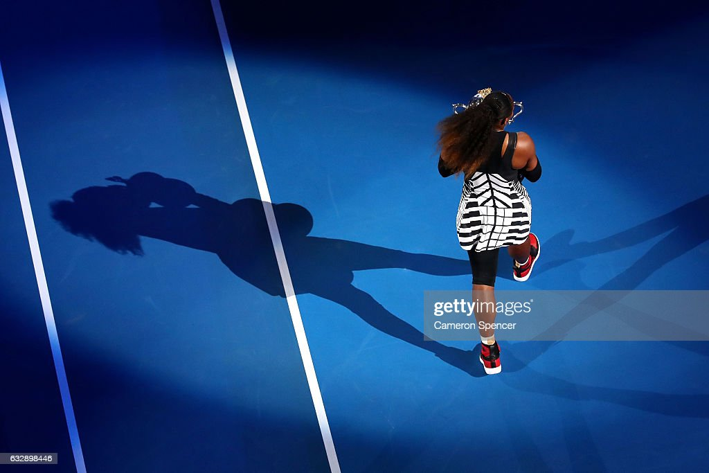 Serena Williams of the United States walks a lap of honour with the Daphne Akhurst Trophy after winning the Women's Singles Final against Venus Williams of the United States on day 13 of the 2017 Australian Open at Melbourne Park on January 28, 2017 in Melbourne, Australia.