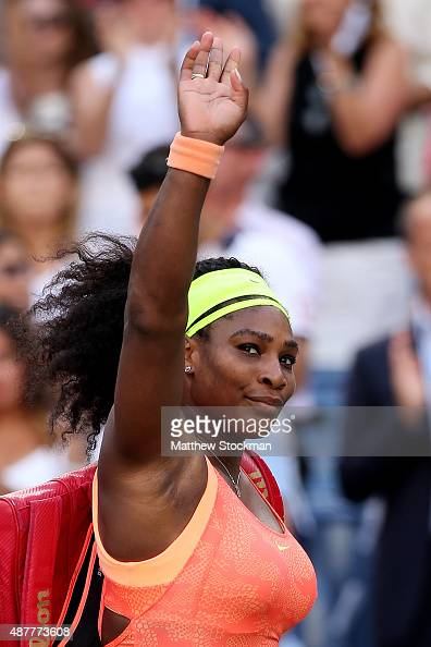 Serena Williams of the United States walks off of the court after loosing to Roberta Vinci of Italy during their Women's Singles Semifinals match on...