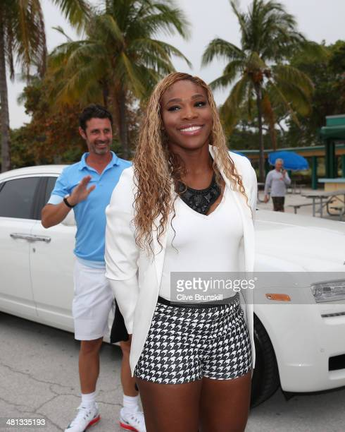 Serena Williams of the United States walks to Crandon Park beach from her car as coach and boyfriend Patrick Mouratoglou follows behind her after her...