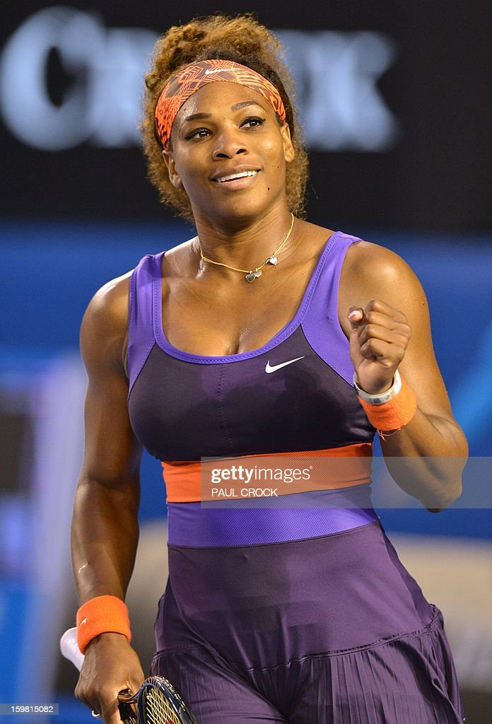 Serena Williams of the US celebrates after her victory against Russia's Maria Kirilenko during their women's singles match on day eight of the Australian Open tennis tournament in Melbourne on January 21, 2013.