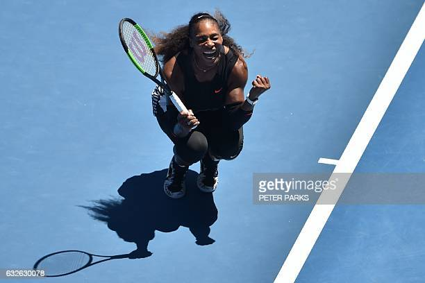 TOPSHOT Serena Williams of the US celebrates her victory against Britain's Johanna Konta in their women's singles quarterfinal match on day ten of...