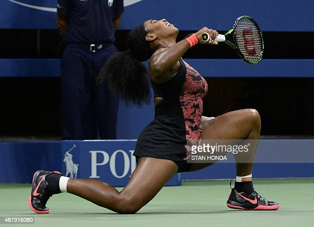 Serena Williams of the US drops to one knee against Venus Williams of the US during their 2015 US Open quarterfinals women's singles match at the...