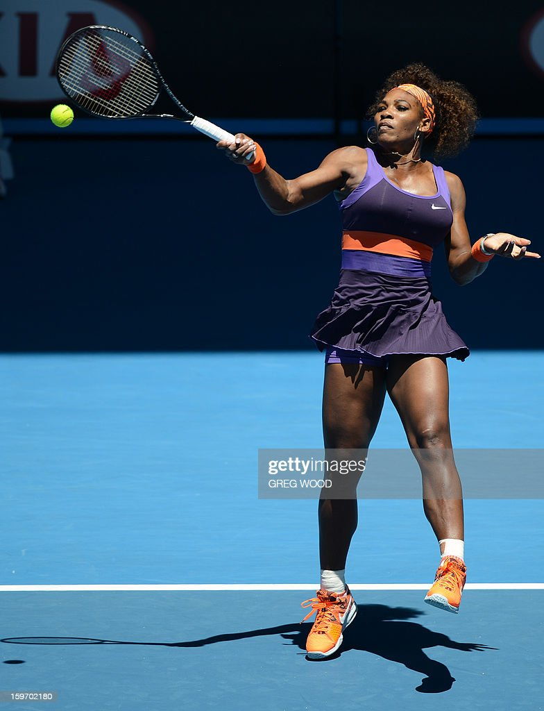 Serena Williams of the US hits a return against Japan's Ayumi Morita during their women's singles match on day six of the Australian Open tennis tournament in Melbourne on January 19, 2013.