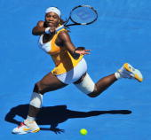 Serena Williams of the US hits a return against Victoria Azarenka of Belarus in their women's singles quarterfinal match on day 10 of the Australian...