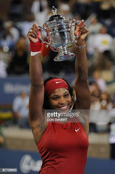 Serena Williams of the US holds her trophy after defeating Jelena Jankovic of Serbia in the women's final at the US Open tennis tournament September...