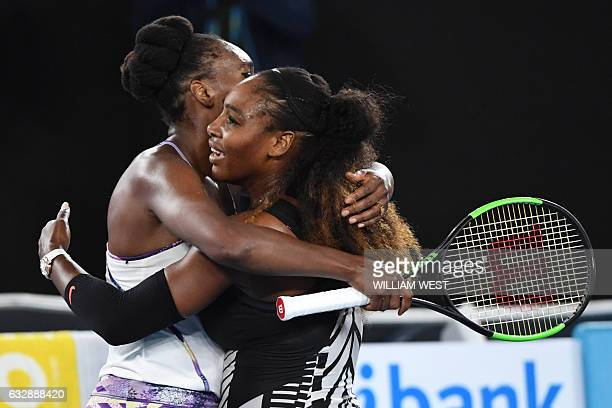 Serena Williams of the US hugs Venus Williams of the US after winning the women's singles final on day 13 of the Australian Open tennis tournament in...