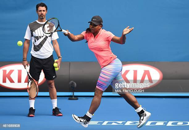 Serena Williams of the US is watched by coach Patrick Mouratoglou as she plays a shot during a practice session ahead of the 2015 Australian Open...