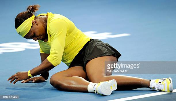 Serena Williams of the US lies on the court after injuring her ankle during her second round women's singles match against Bojana Jovanovski of...