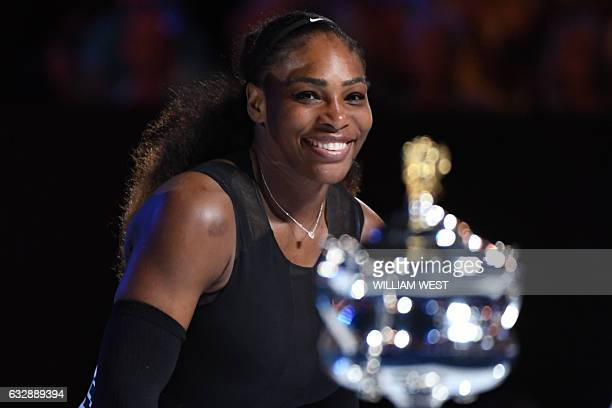 Serena Williams of the US looks at the championship trophy during the awards ceremony after her victory against Venus Williams of the US in the...