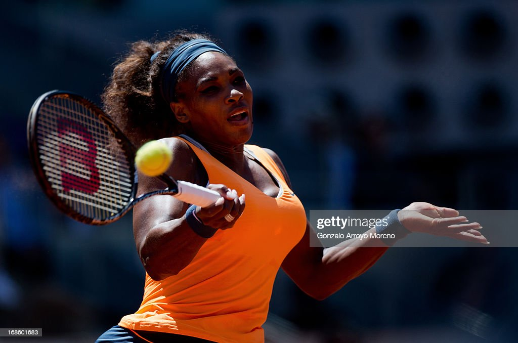 Serena Williams of the US plays a backhand to Maria Sharapova of Russia during the final match on day nine of the Mutua Madrid Open tennis tournament at the Caja Magica on May 12, 2013 in Madrid, Spain.
