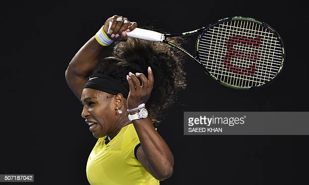 TOPSHOT Serena Williams of the US plays a forehand return during her women's singles semifinal match against Poland's Agnieszka Radwanska on day...