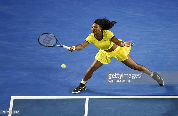Serena Williams of the US plays a forehand return during her women's singles final match against Germany's Angelique Kerber on day thirteen of the...
