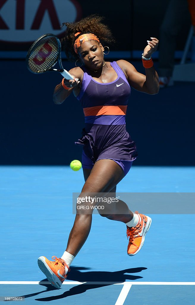 Serena Williams of the US plays a return during her women's singles match against Ayumi Morita of Japan on the sixth day of the Australian Open tennis tournament in Melbourne on January 19, 2013.