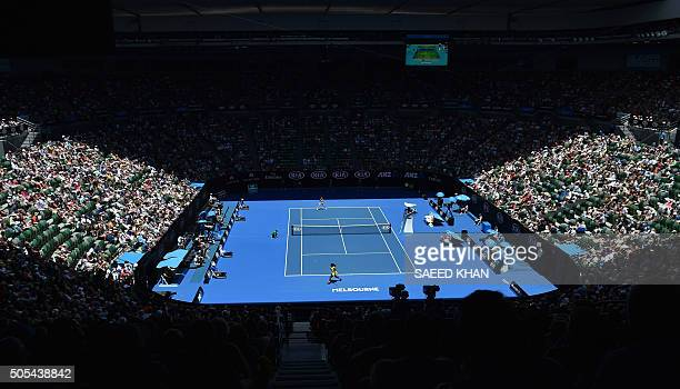 Serena Williams of the US plays a return during her women's singles match against Italy's Camila Giorgi on day one of the 2016 Australian Open tennis...
