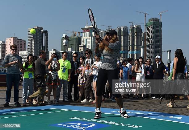 Serena Williams of the US plays tennis onboard a boat on the Yangtze River during a promotional event for the Wuhan Open tennis tournament in Wuhan...
