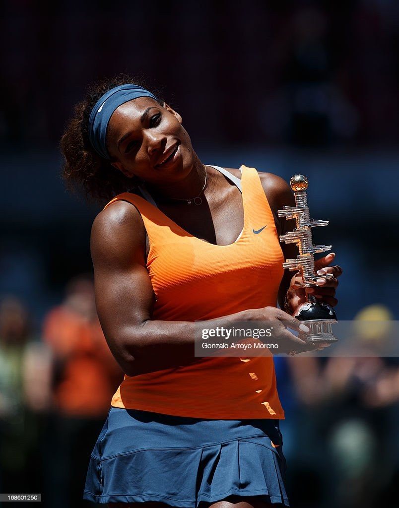<a gi-track='captionPersonalityLinkClicked' href=/galleries/search?phrase=Serena+Williams+-+Tennis+Player&family=editorial&specificpeople=171101 ng-click='$event.stopPropagation()'>Serena Williams</a> of the US poses with the trophy after winning her final match against Maria Sharapova of Russia on day nine of the Mutua Madrid Open tennis tournament at the Caja Magica on May 12, 2013 in Madrid, Spain.