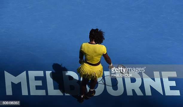 Serena Williams of the US prepares to serve against Russia's Margarita Gasparyan during their women's singles game on day seven of the 2015...