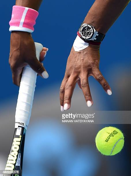Serena Williams of the US prepares to serve during her women's singles match against Spain's Garbine Muguruza on day eight of the 2015 Australian...