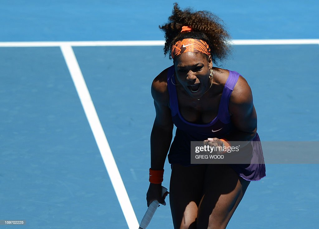 Serena Williams of the US reacts after a point against Japan's Ayumi Morita during their women's singles match on day six of the Australian Open tennis tournament in Melbourne on January 19, 2013.