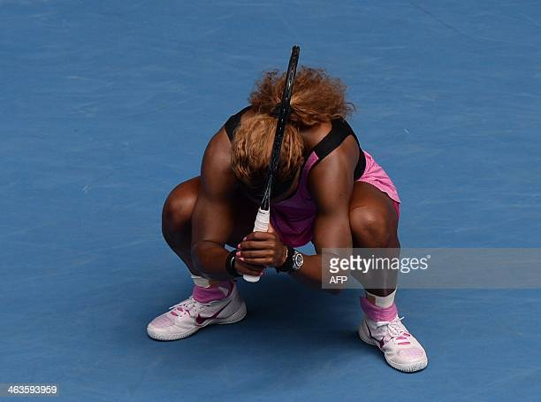 Serena Williams of the US reacts after her serve was broken in the second set during her women's singles match against Serbia's Ana Ivanovic on day...