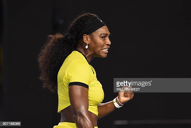 TOPSHOT Serena Williams of the US reacts during her women's singles semifinal match against Poland's Agnieszka Radwanska on day eleven of the 2016...