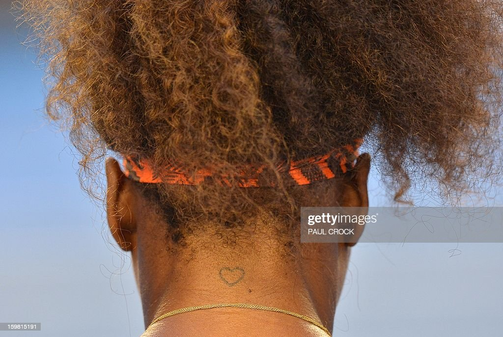 Serena Williams of the US rests during a break in her women's singles match against Russia's Maria Kirilenko on day eight of the Australian Open tennis tournament in Melbourne on January 21, 2013.