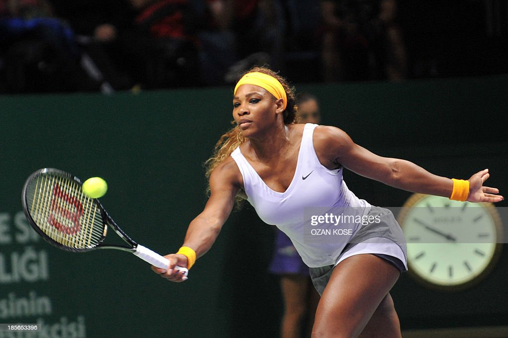 Serena Williams of the US returns the ball to Agnieszka Radwanska of Poland on October 23, 2013 during a WTA Championships tennis match in Istanbul.
