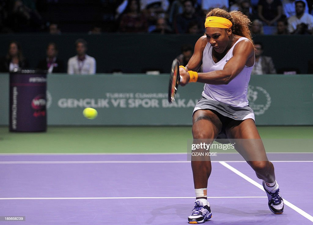 Serena Williams of the US returns the ball to Agnieszka Radwanska of Poland during their WTA Championships tennis match in Istanbul on October 23, 2013.